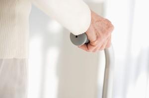 Elderly Hand Holding Cane